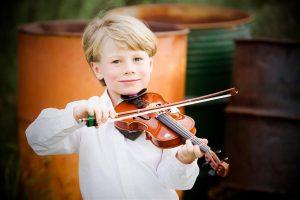 Taunya Fagan son playing violin
